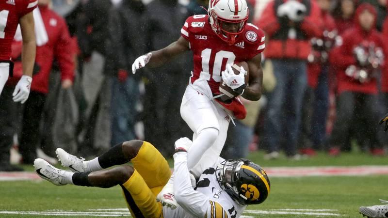 Nebraska wide receiver JD Spielman (10) is tackled by Iowa defensive back Michael Ojemudia (11)...