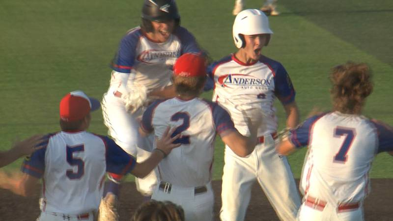 Cam Teinert is mobbed by Anderson Ford teammates after hitting a walk-off 2 RBI single in the...