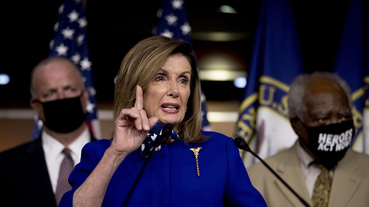 House Speaker Nancy Pelosi of Calif., accompanied by Rep. Dan Kildee, D-Mich., left, and Rep....