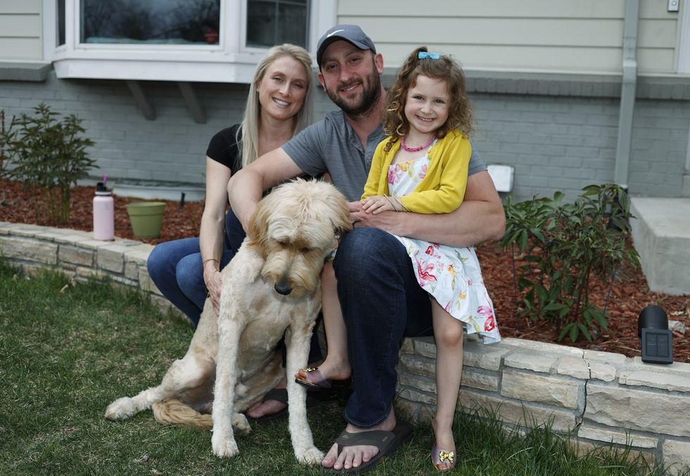 Eli Oderberg, center, sits with Katie Evers, left, their 4-year-old daughter, Everlee, and the...
