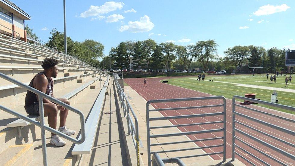Senior defensive lineman Gerald Morris watches practice get started from the bleachers