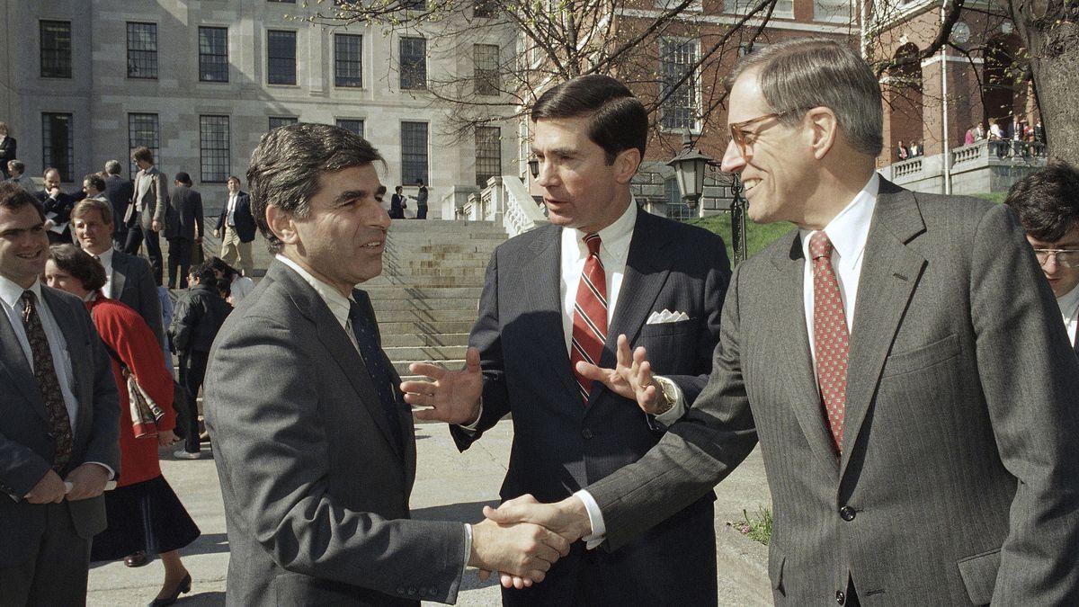 FILE - In this April 27, 1987 file photo, Massachusetts Gov. Michael Dukakis, left, shakes the...