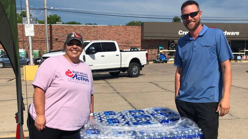 Culligan of Crete donates a pallet of Culligan water to the Blue Valley Community Action -...