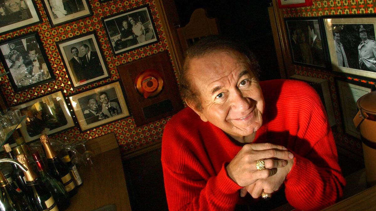 """FILE - In this Jan. 1, 2002 file photo, singer and actor Trini Lopez poses in Dallas. Trini Lopez, a singer and guitarist who gained fame for his versions of """"Lemon Tree"""" and """"If I Had a Hammer"""" in the 1960s and took his talents to Hollywood, has died. He was 83.  Filmmaker P. David Ebersole confirmed that Lopez died Tuesday, Aug. 11, 2020 at Desert Regional Medical Center in Palm Springs, Calif., from COVID-19.  (Cheryl Diaz Meyer/The Dallas Morning News via AP)"""