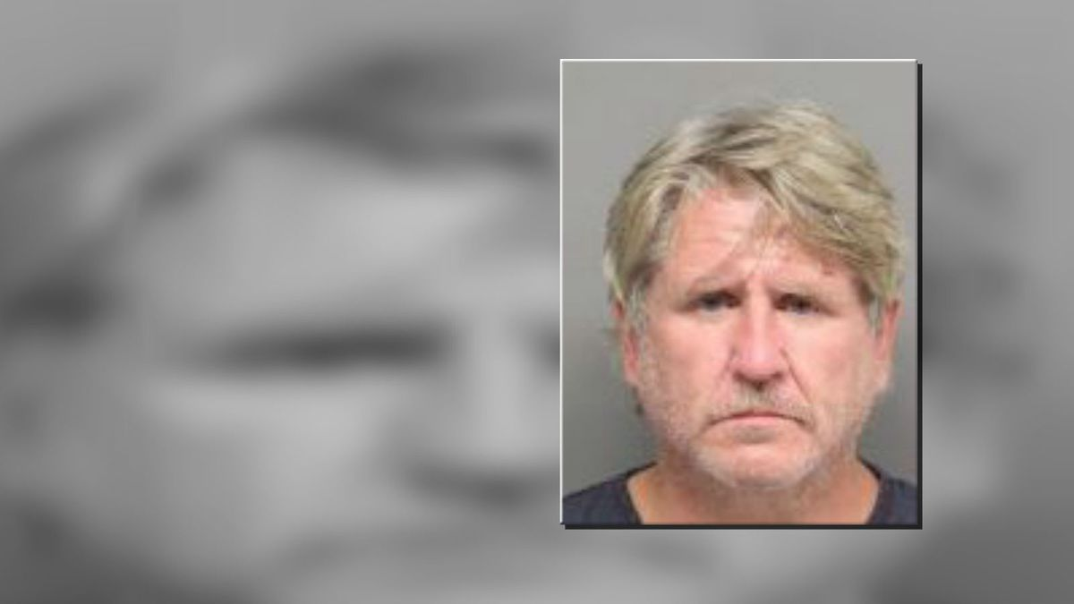A man was arrested for pointing a shotgun at multiple people.