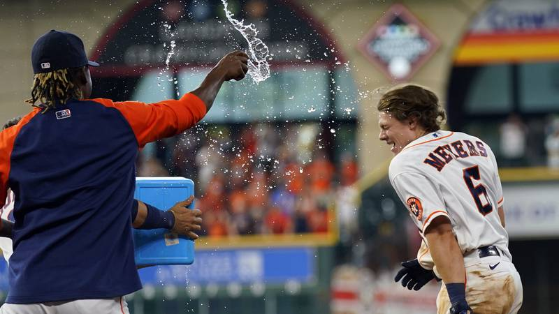 Houston Astros' Jake Meyers celebrates with teammates after hitting a walk-off game-winning...