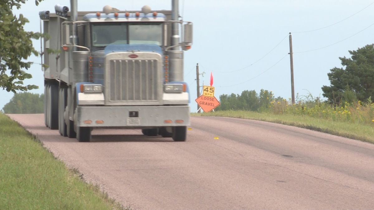 A truck drives down 148th St., shortly after Lancaster County chip sealed the road. (Source:...