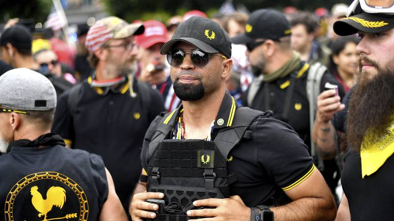 FILE - In this Aug. 17, 2019, file photo, Proud Boys chairman Enrique Tarrio rallies in...