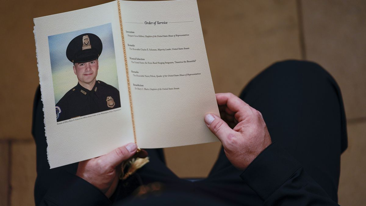 FILE - In this Feb. 3, 2021, file photo, a U.S. Capitol Police officer holds a program during a...