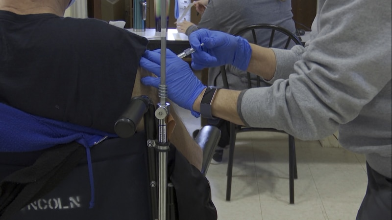 A veteran receives a COVID-19 vaccine at the Lincoln VA Clinic Tuesday morning.