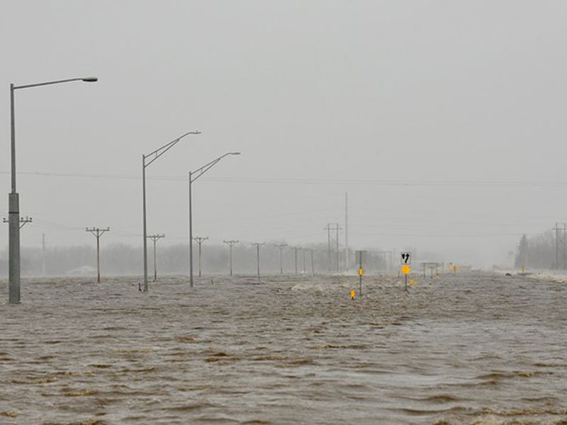 In this March 14, 2019 photo, Highway 81 north of Norfolk, Neb., is covered in flood waters....