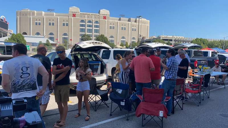 People spent hours hanging outside of Memorial Stadium tailgating, playing games, drinking and...
