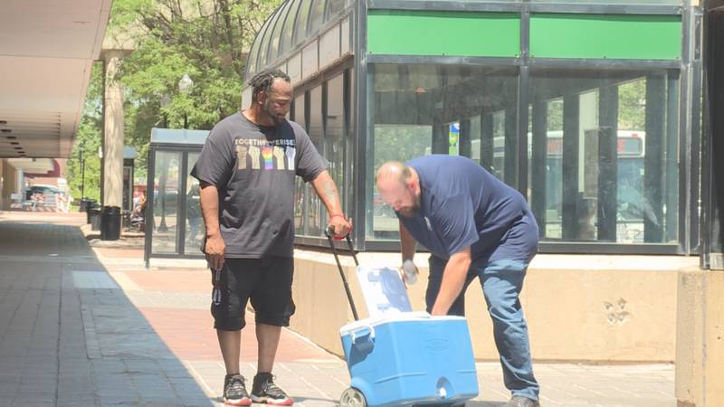 By shuttlebus or by foot, local non-profits are getting food and water into the hands of those...