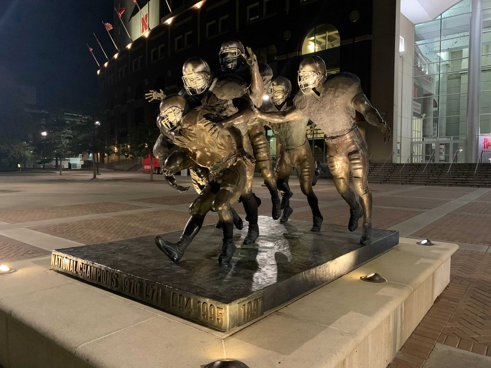"""The famous """"National Champions"""" statue outside the east entrance to Memorial Stadium was spray..."""