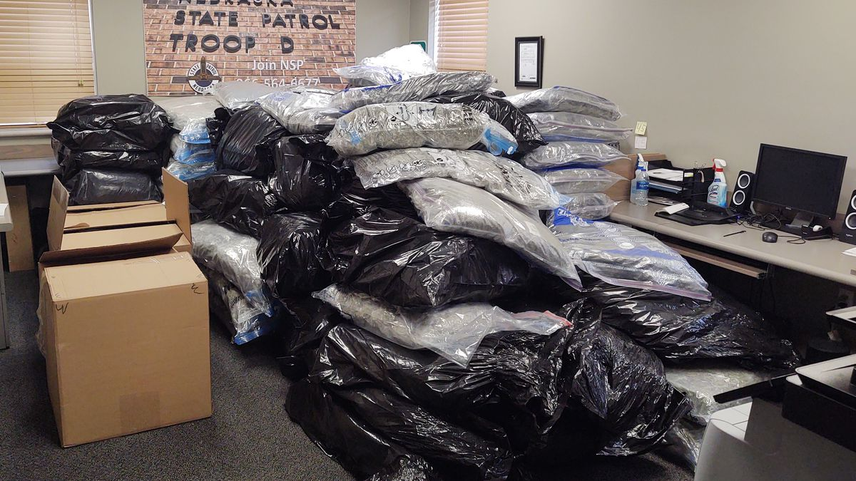 The search revealed 2,295 pounds of marijuana, which was concealed inside cardboard boxes...