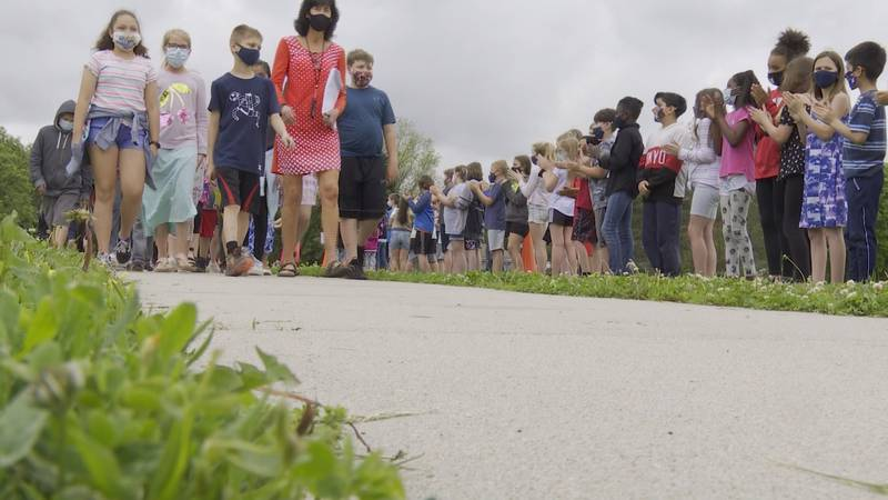 Zeman Elementary fifth graders are cheered on by classmates to honor their last day in...