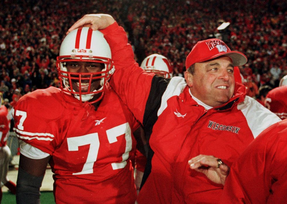File- This Nov. 21, 1998 file photo shows Wisconsin's coach Barry Alvarez congratulating...