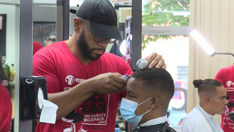 Right outside the College of Hair Design near 11th and M Streets, volunteers are giving out...