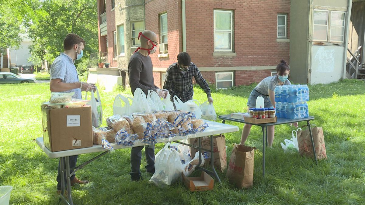 Organizers pack grocery bags for Sunday distributions in the Everett neighborhood.