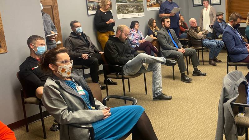 Kearney residents wait to speak at public hearing before city council vote on mask mandate.