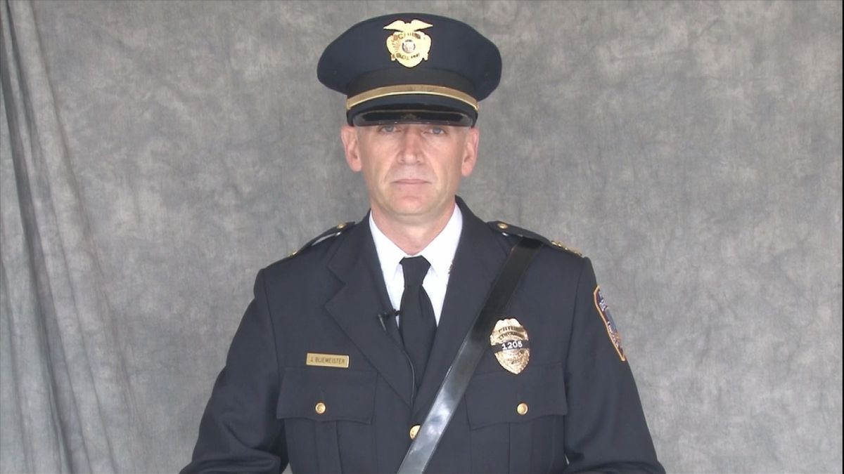 Lincoln Police Chief Jeff Bliemeister delivers a video message during the funeral of Invesitgator Mario Herrera.
