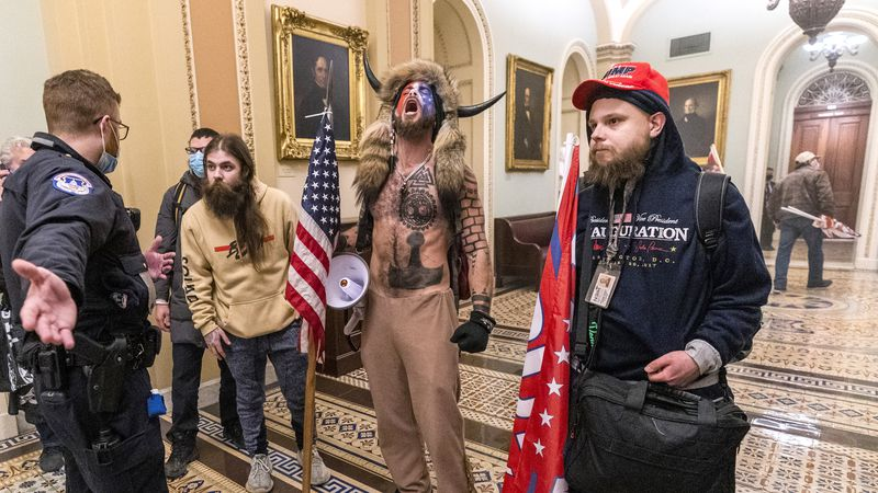 Supporters of President Donald Trump are confronted by Capitol Police officers outside the...