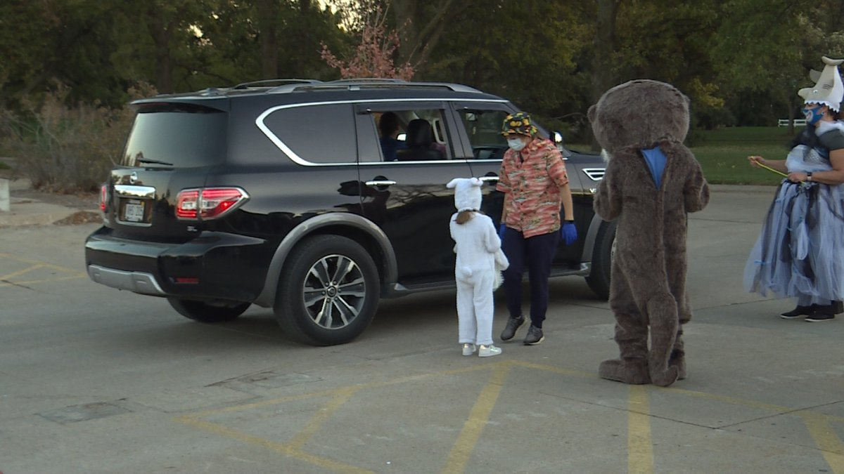 Several people help provide kids a fun Halloween experience.