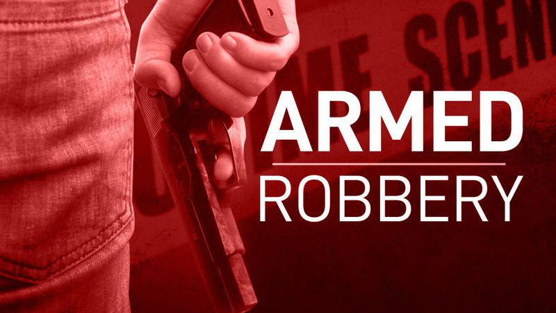 Lincoln police are looking for a group of men who robbed three people at gunpoint.