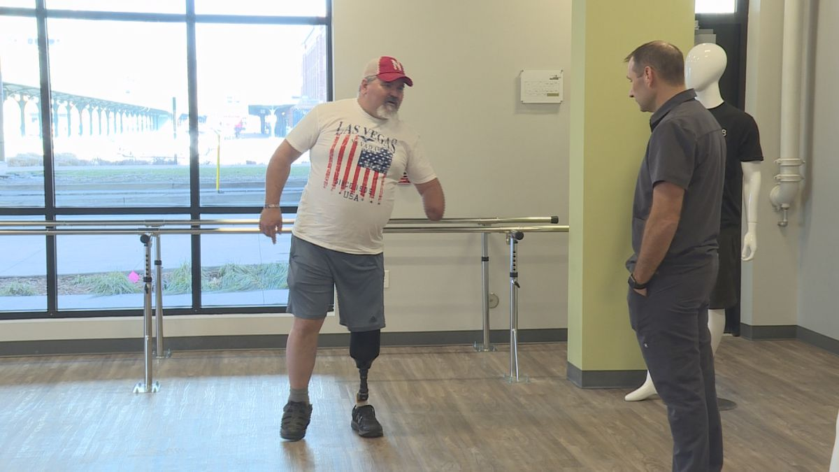 Jim Earnhart tests out a new prosthetic at Limb Lab