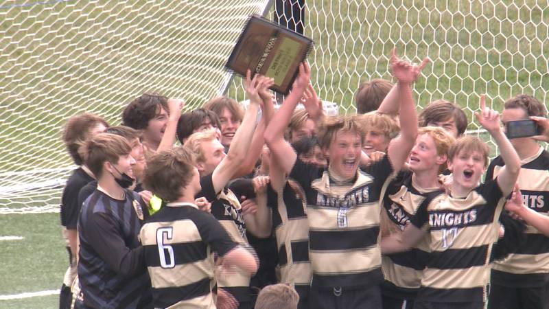 Lincoln Southeast soccer players celebrate the Knights' district championship win over Omaha...