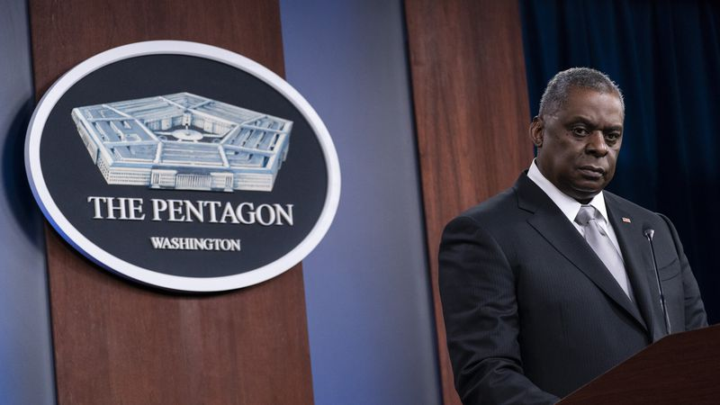 Secretary of Defense Lloyd Austin listens to a question as he speaks during a media briefing at...