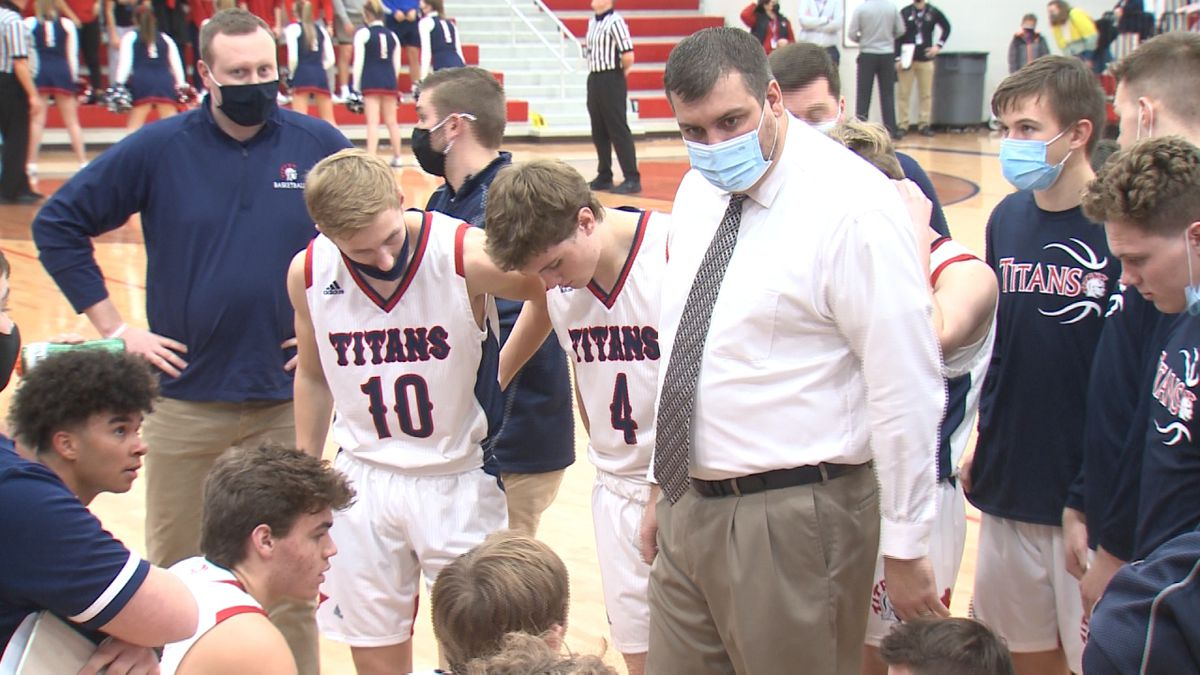 Norris basketball coach Jimmy Motz talks to his team during a timeout at the EMC Tournament.