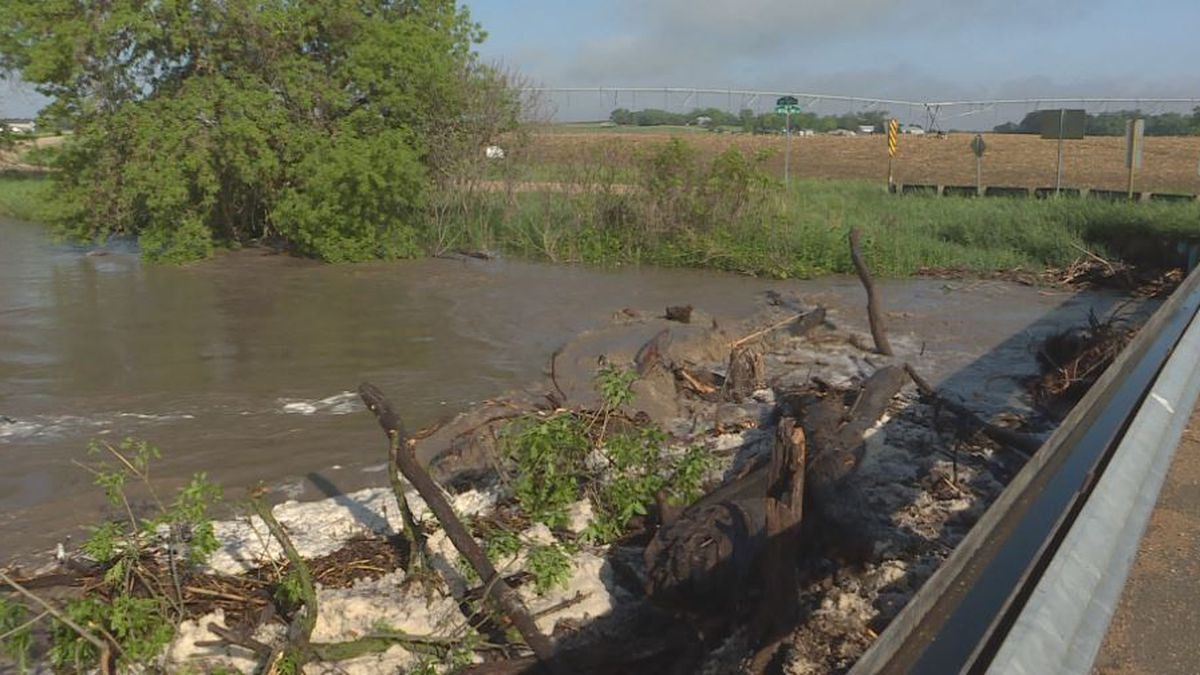 Branches block water flood on the Little Blue River in Ayr causing streets to flood. (KSNB)